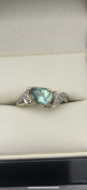 18 carat yellow gold ring Set with a pear shaped aquamarine and set with diamonds Size N