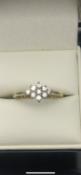 18 carat yellow gold diamond ringSet with 9 diamondsSize K