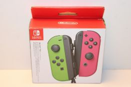 Joy-Con Pair Green/Pink (Nintendo Switch) £60.86Condition ReportAppraisal Available on Request- All