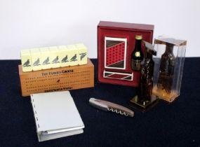 A Famous Grouse Dominoes Set A Moet et Chandon Waiters Friend A Moet et Chandon Ring Binder Note pad