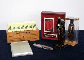 A Famous Grouse Dominoes Set A Moet et Chandon Waiters Friend A Moet et Chandon Desk Top Note pad