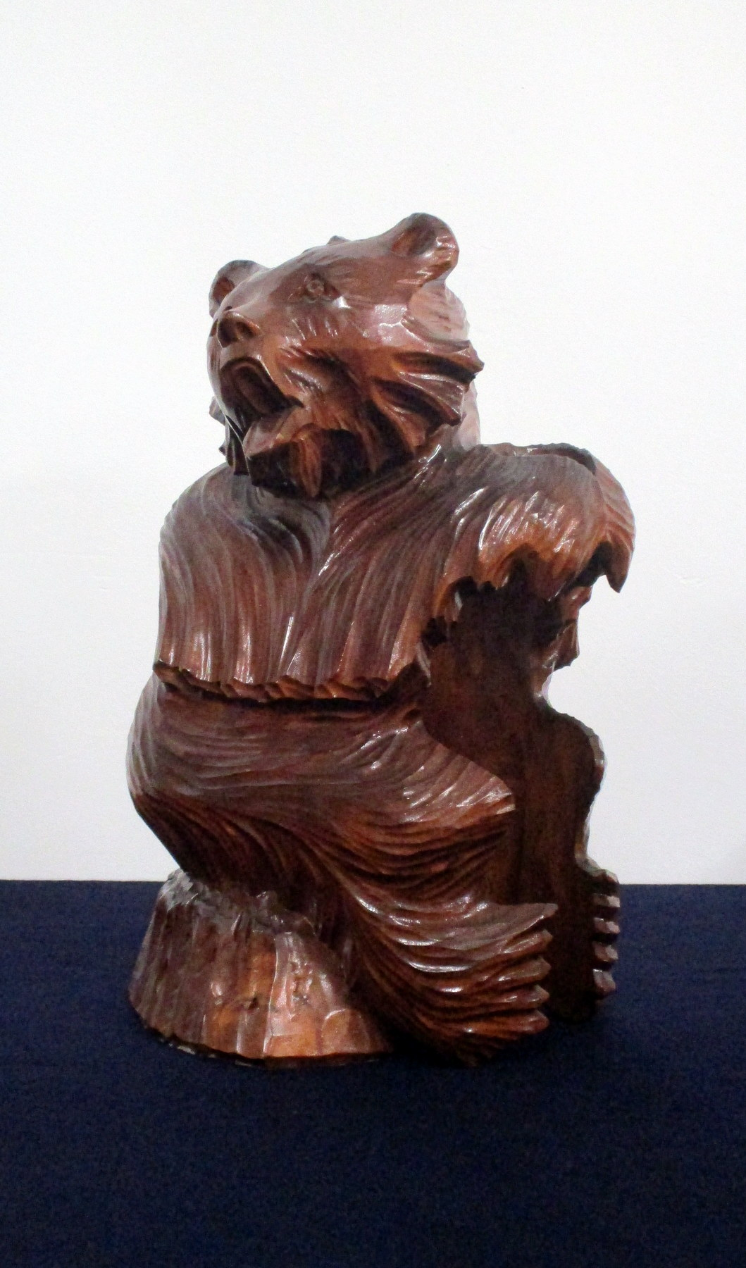 A Carved Wood Bottle Holder in the Form of a Bear
