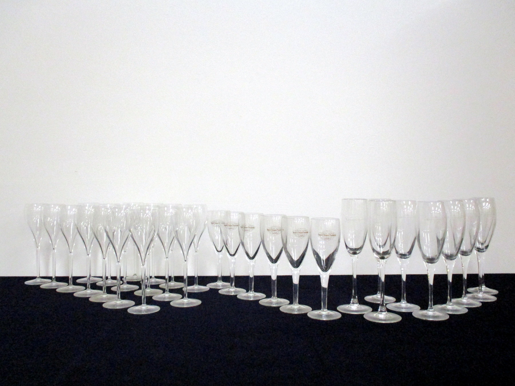 A collection of 32 Champagne Flutes including Moet et Chandon and Joseph Perrier