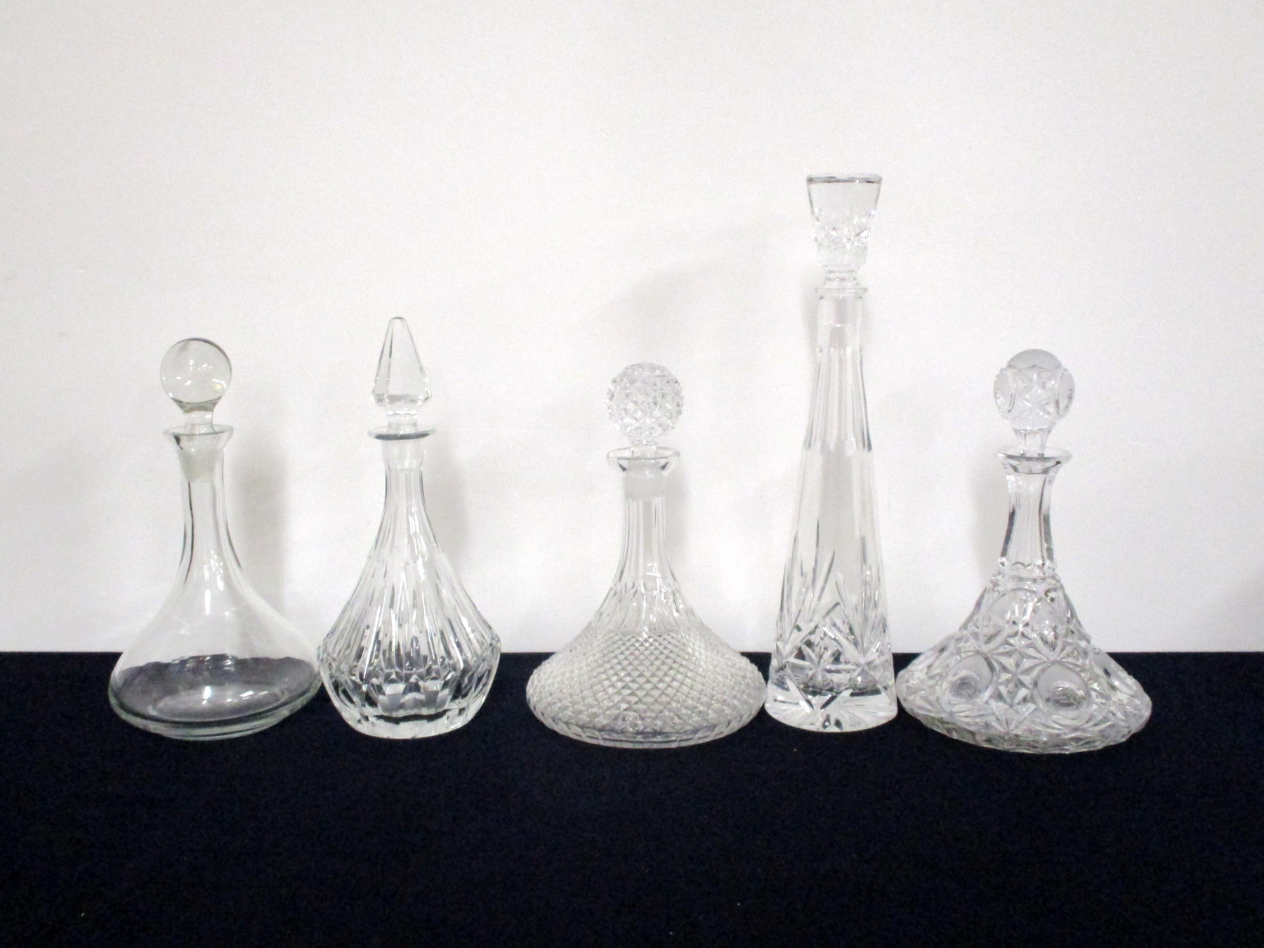 Five Assorted Decanters with Stoppers, including Ships Decanter and Hobnail cut glass
