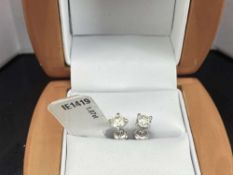 Pair of New 1.07 Carat Round Cut VS1/E Diamond Stud Earrings On 14K Hallmarked White Gold