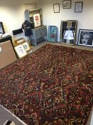 A Large Red Bakthiari Carpet, Decorated With Stylised Flowers in Vases To Centre, Floral Borders,