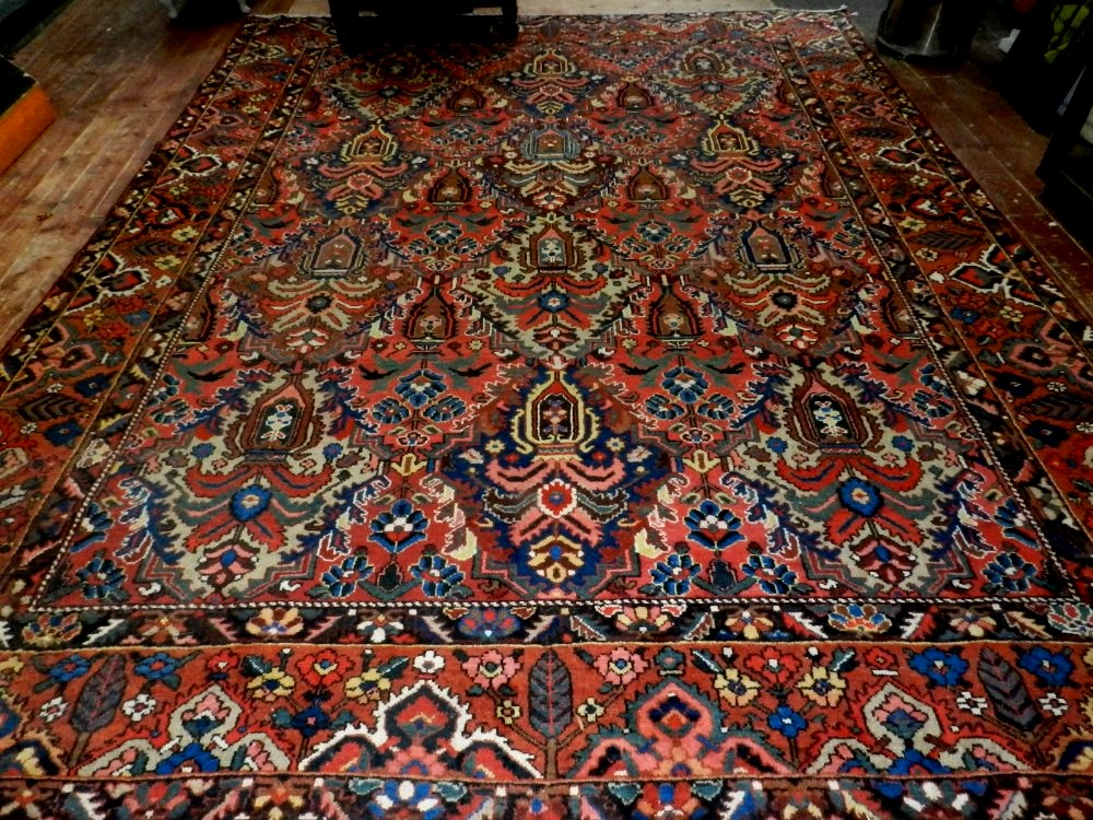 A Large Red Bakthiari Carpet, Decorated With Stylised Flowers in Vases To Centre, Floral Borders, - Image 2 of 2