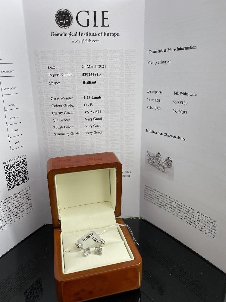 Pair of New 1.23 Carat Round Cut VS2/D Diamond Stud Earrings On 14K Hallmarked White Gold - Image 4 of 4