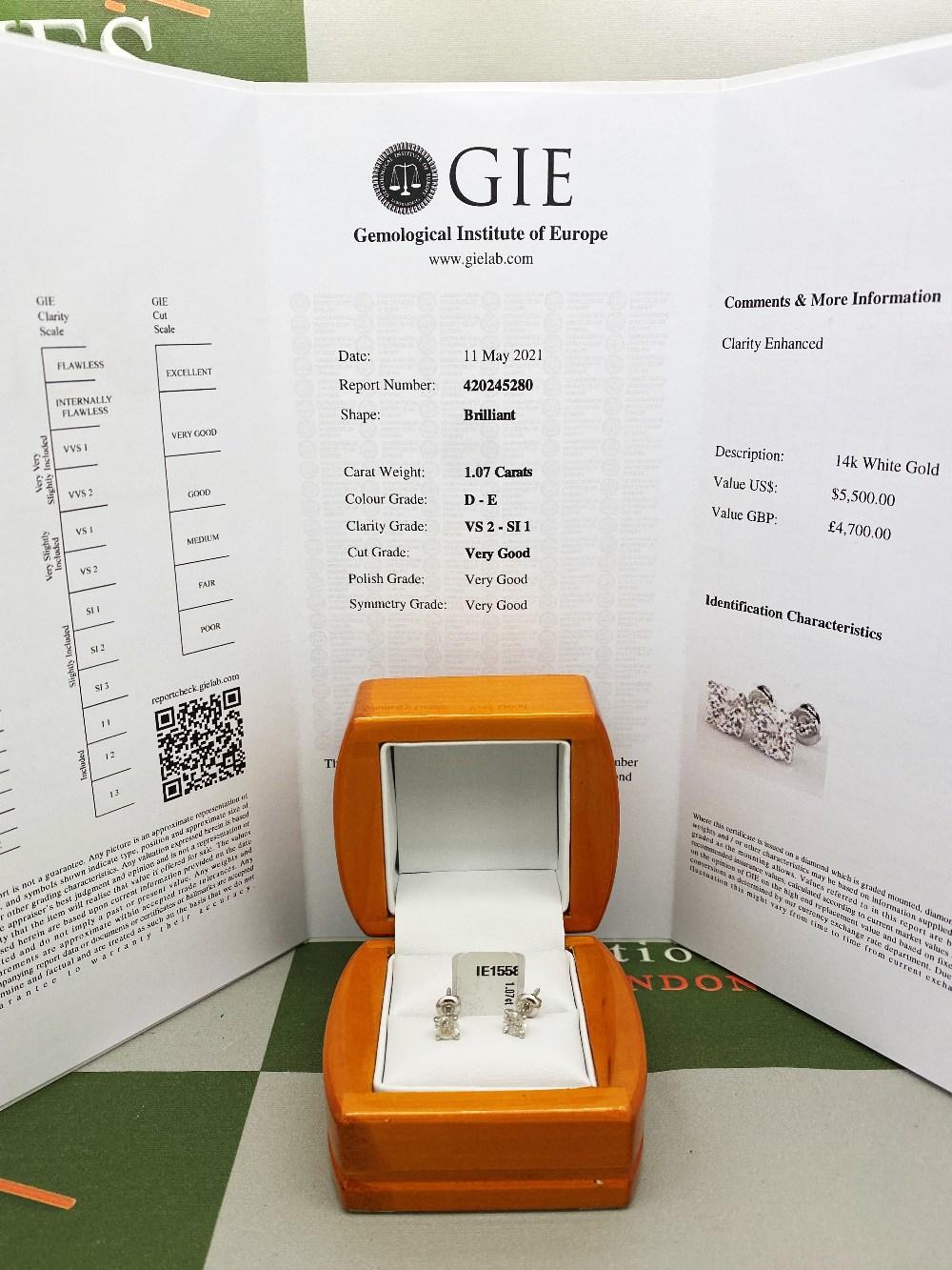 Pair of New 1.07 Carat Round Cut VS2/D Diamond Stud Earrings On 14K Hallmarked White Gold