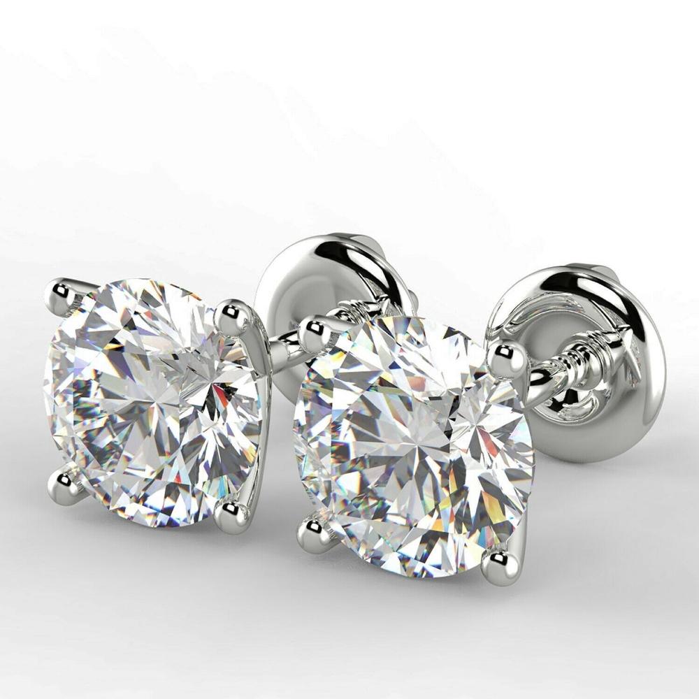 Pair of New 1.36 Carat Round Cut VS1/D Diamond Stud Earrings On 14K Hallmarked White Gold