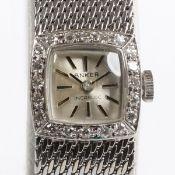 Damenarmbanduhr mit rechteckigem Zifferblatt und Diamantlünette585/- Weißgold, gestemp. Gew