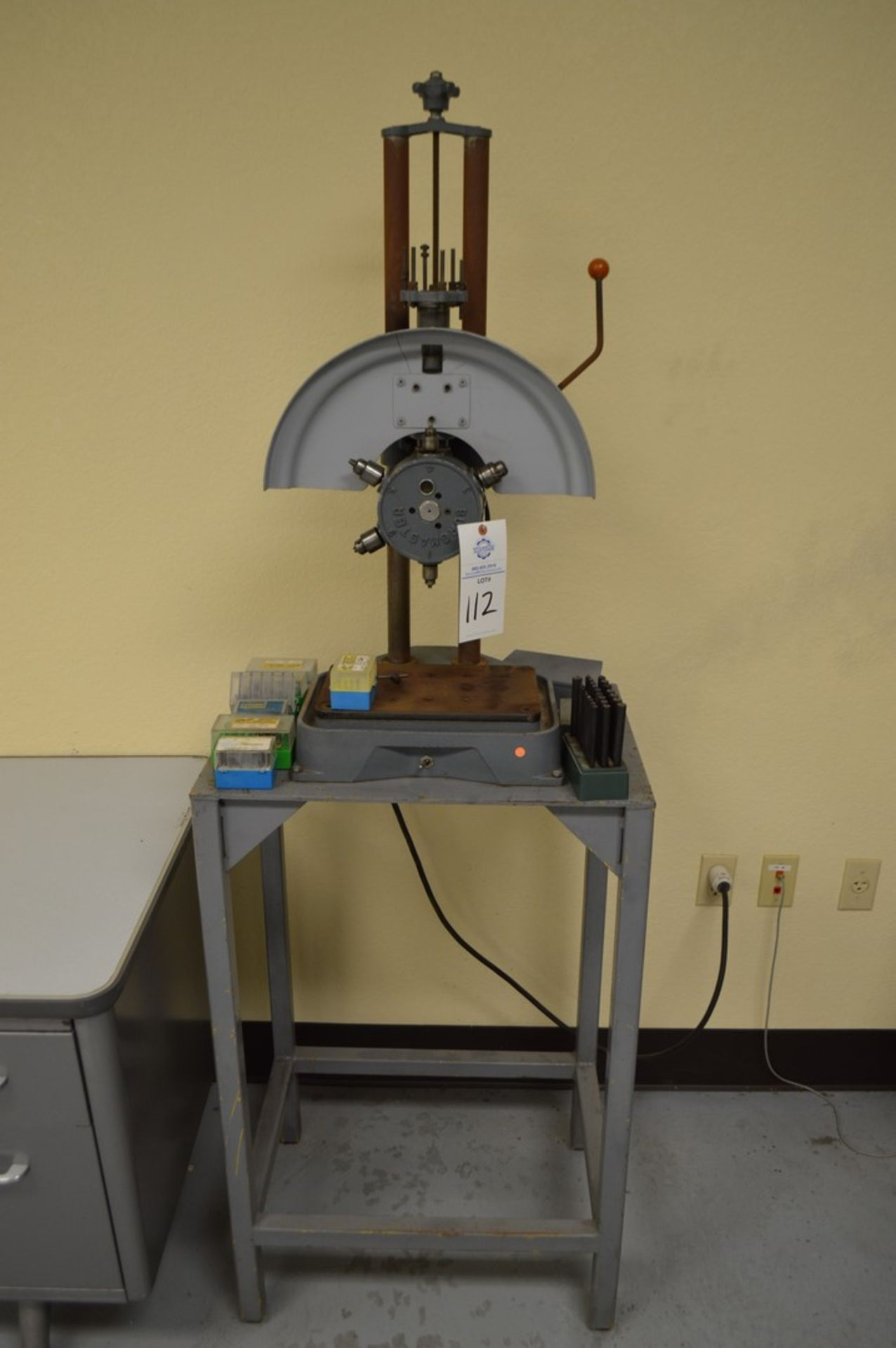 Burgmaster, 6 position, several taps, gauges and drill index included
