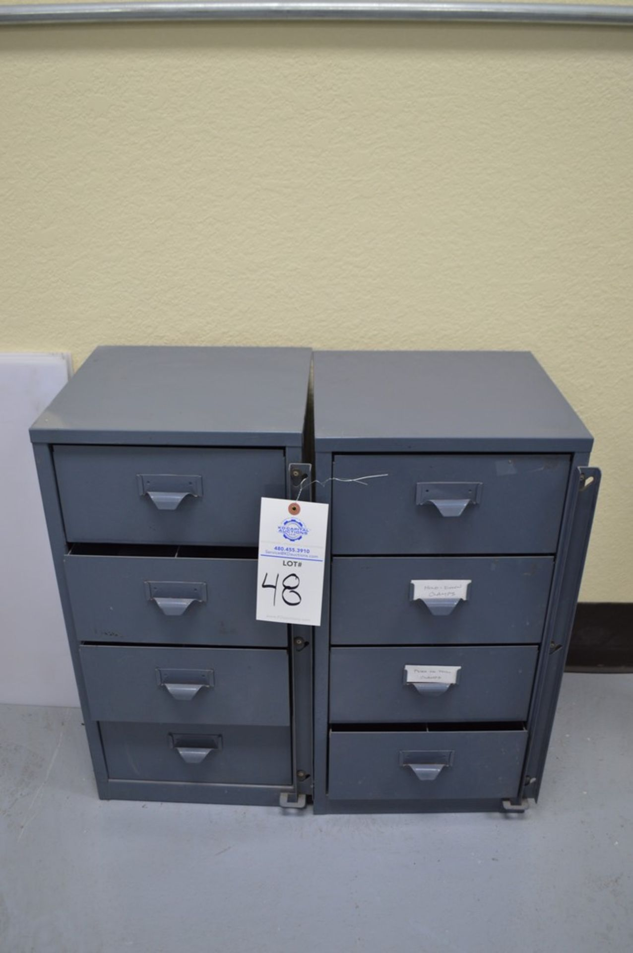 2 small grey 4 drawer cabinets with large assortment of various Di-Stay-Co hold down clamps