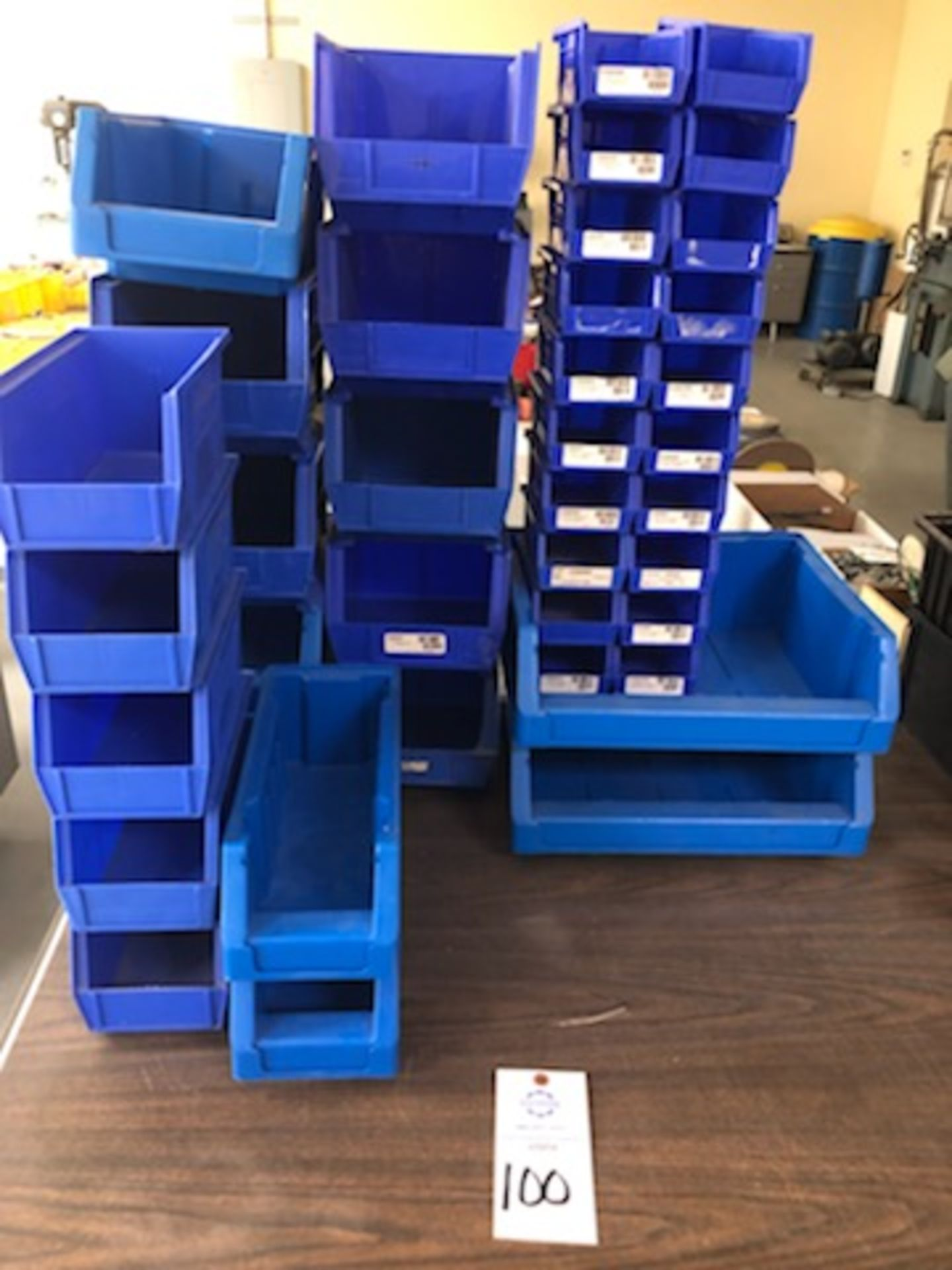 Assorted hard plastic blue parts bins of various sizes
