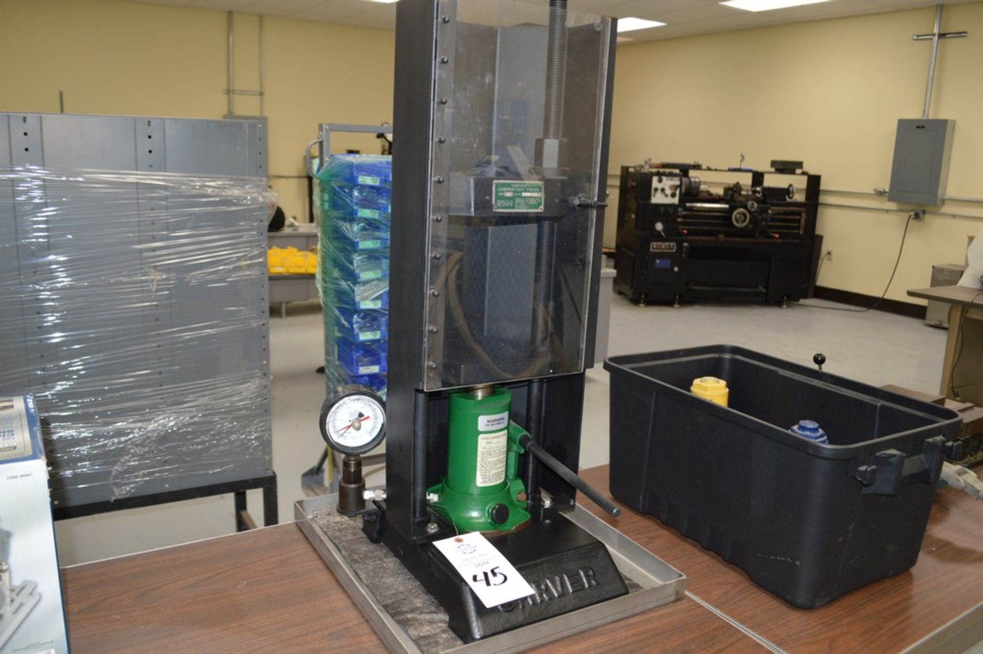 "Carver Model C Laboratory Press, 5 1/8"" max ram stroke, on metal tray"
