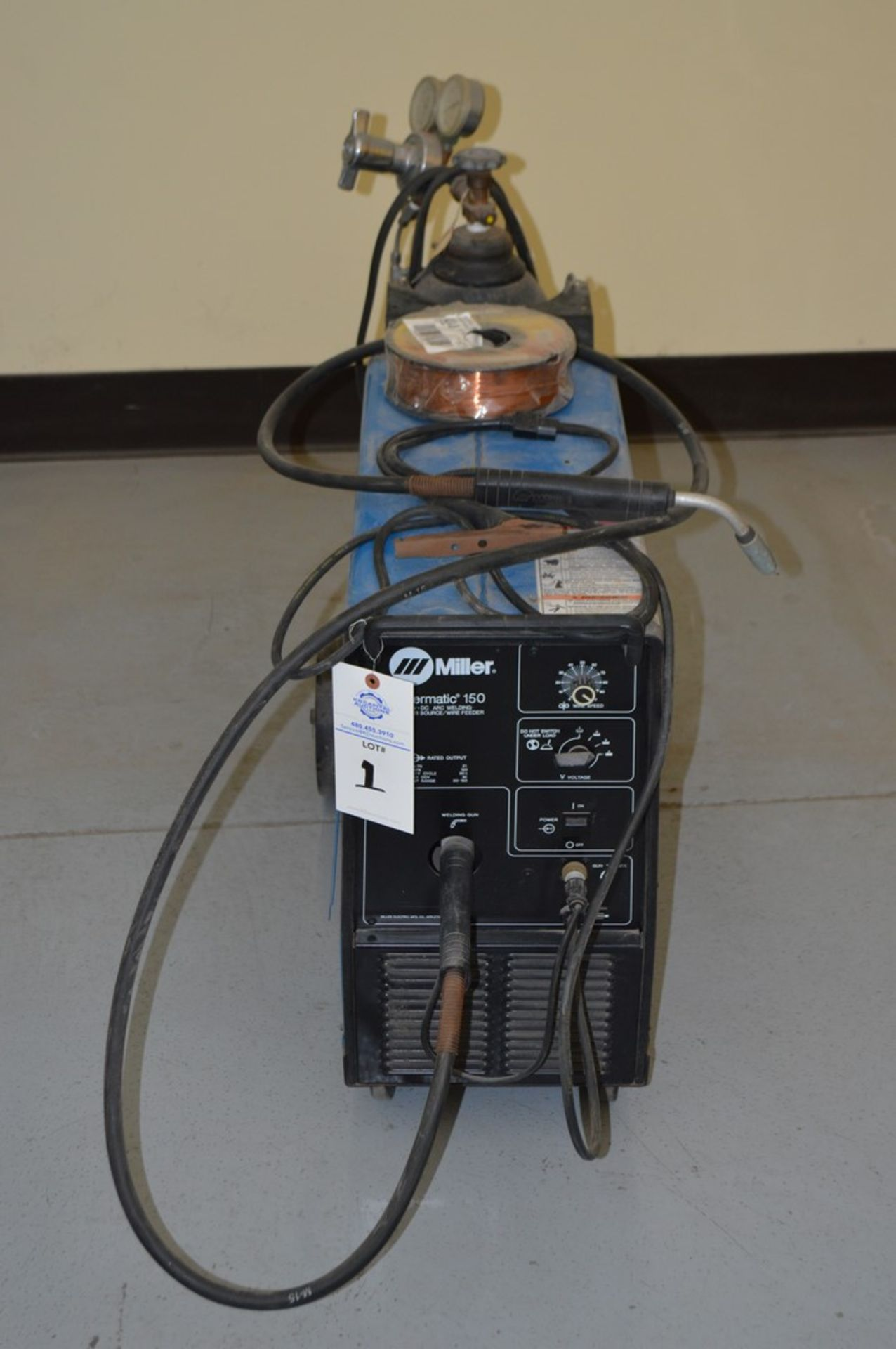 Miller Millermate 150 MIG welder with rolling cart with extra spoil of wire and small argon tank