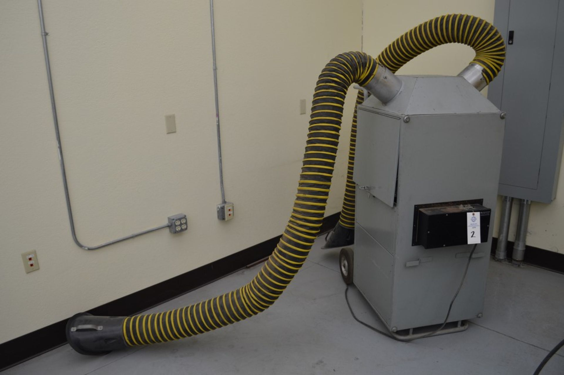 Vacuum/electrostatic bag house dust collector system