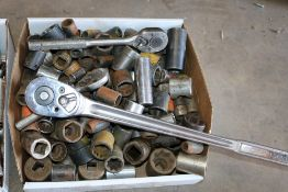 Box of various size sockets and socket wrenches