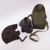 An Avon WWII gas mask with bag, and a leather flying cap. (2)