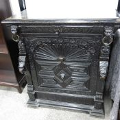 A Victorian grotesque carved ebonised buffet, the