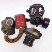 A WWII no 4 mk 3 gas mask respirator with canister and haversack, together with an Avon 1989 gas mas