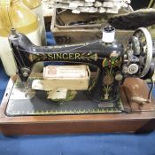 A Singer hand sewing machine, model number F882860