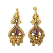 A pair of early Victorian gold, garnet foliate repousse drop earrings