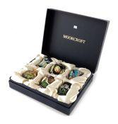 A boxed set of six Moorcroft miniature vases