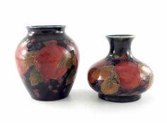 William Moorcroft, two small Pomegranate vases