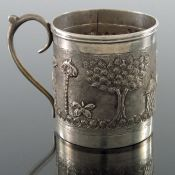 An Indian white metal mug, late 19th century