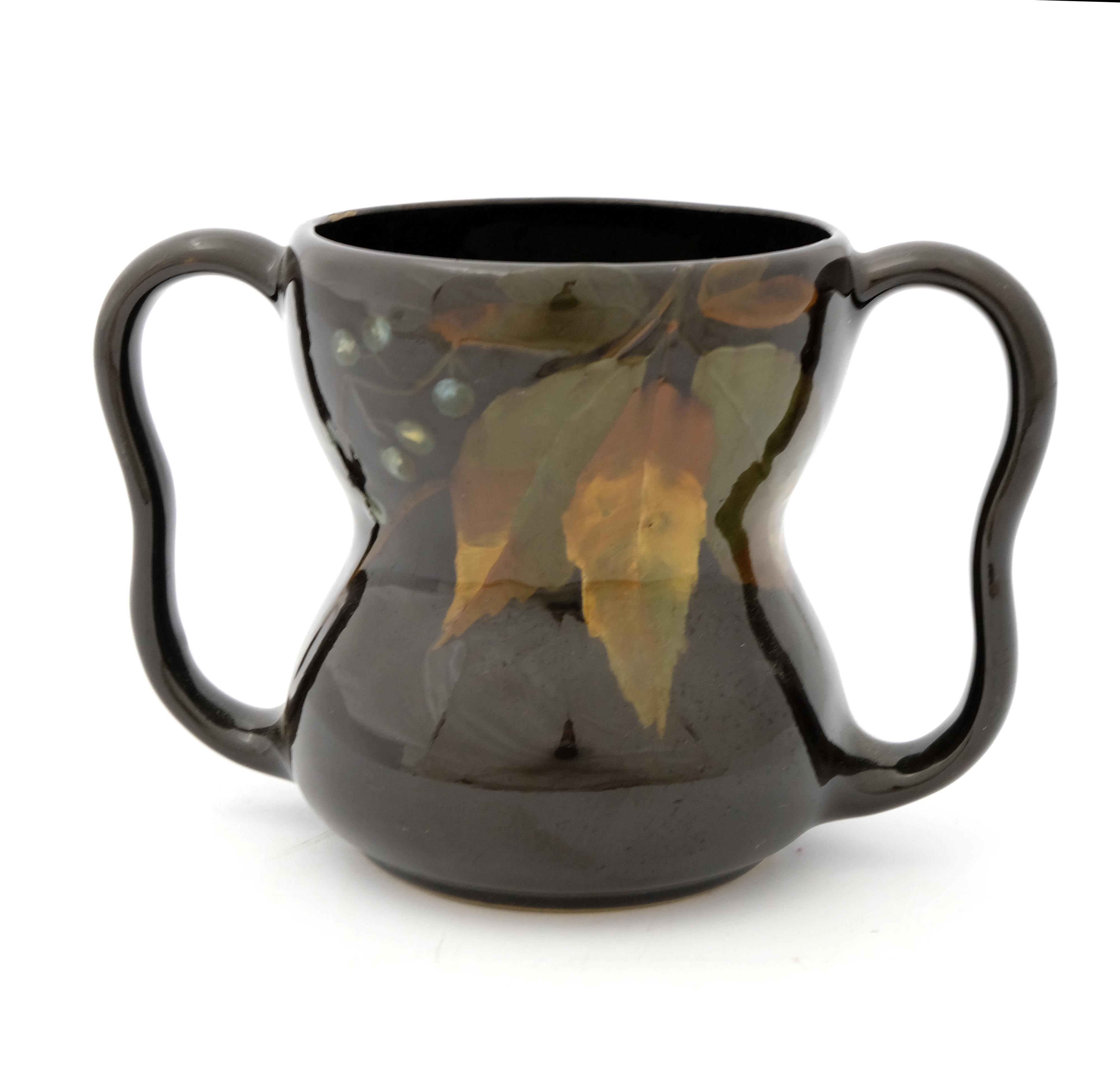 Weller Pottery, a Dickensware twin handled vase
