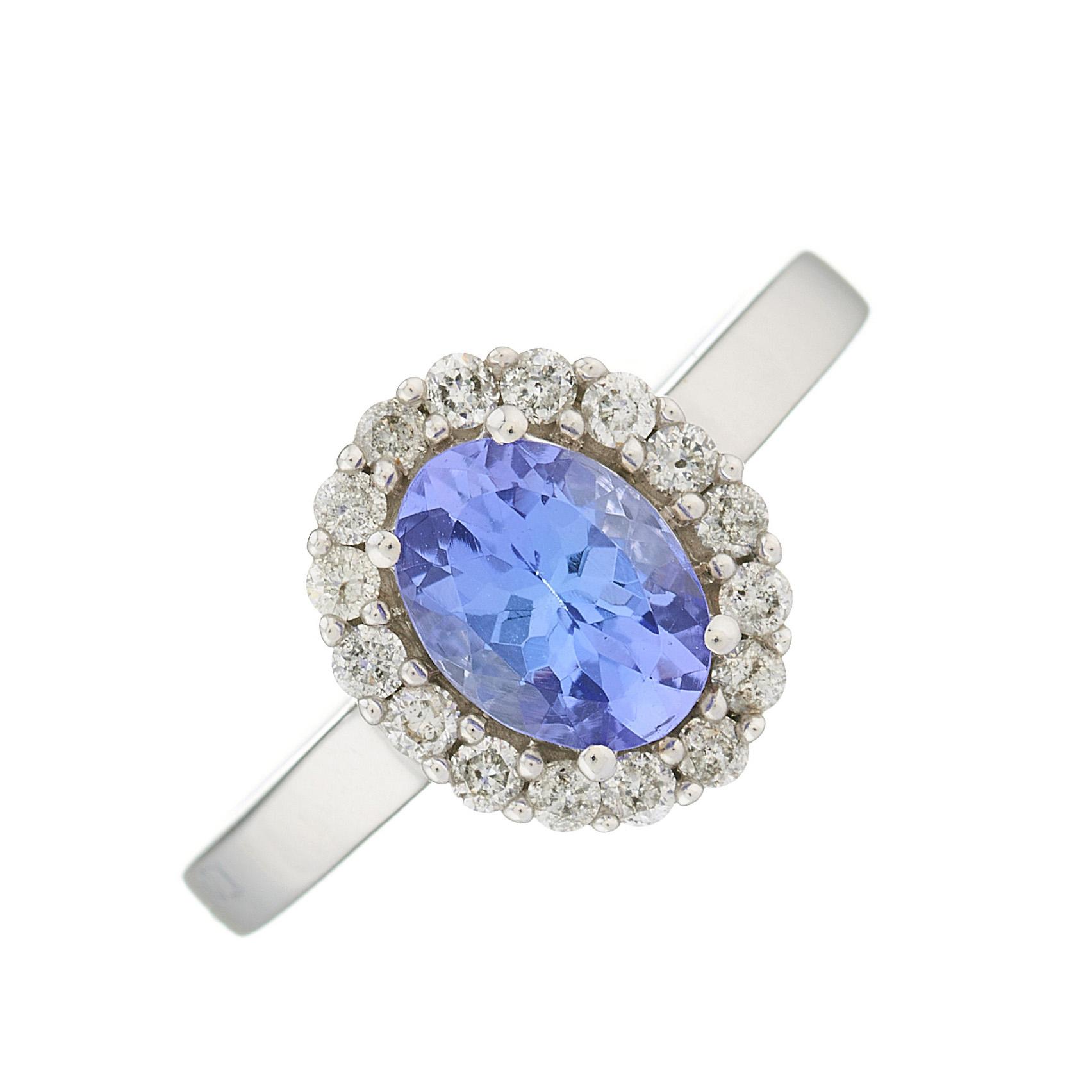 A 14ct gold tanzanite and brilliant-cut diamond cluster ring