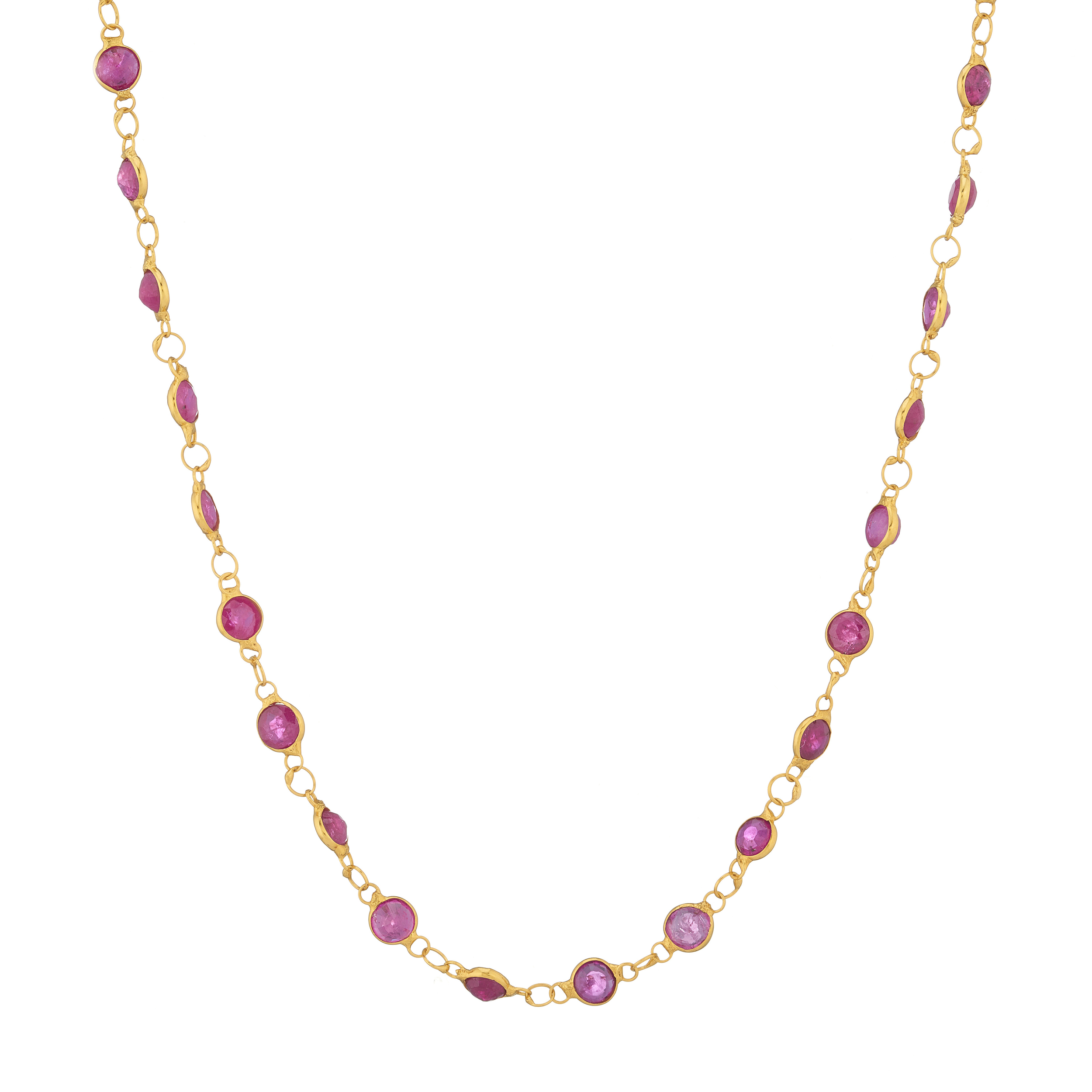 A 14ct gold ruby line necklace