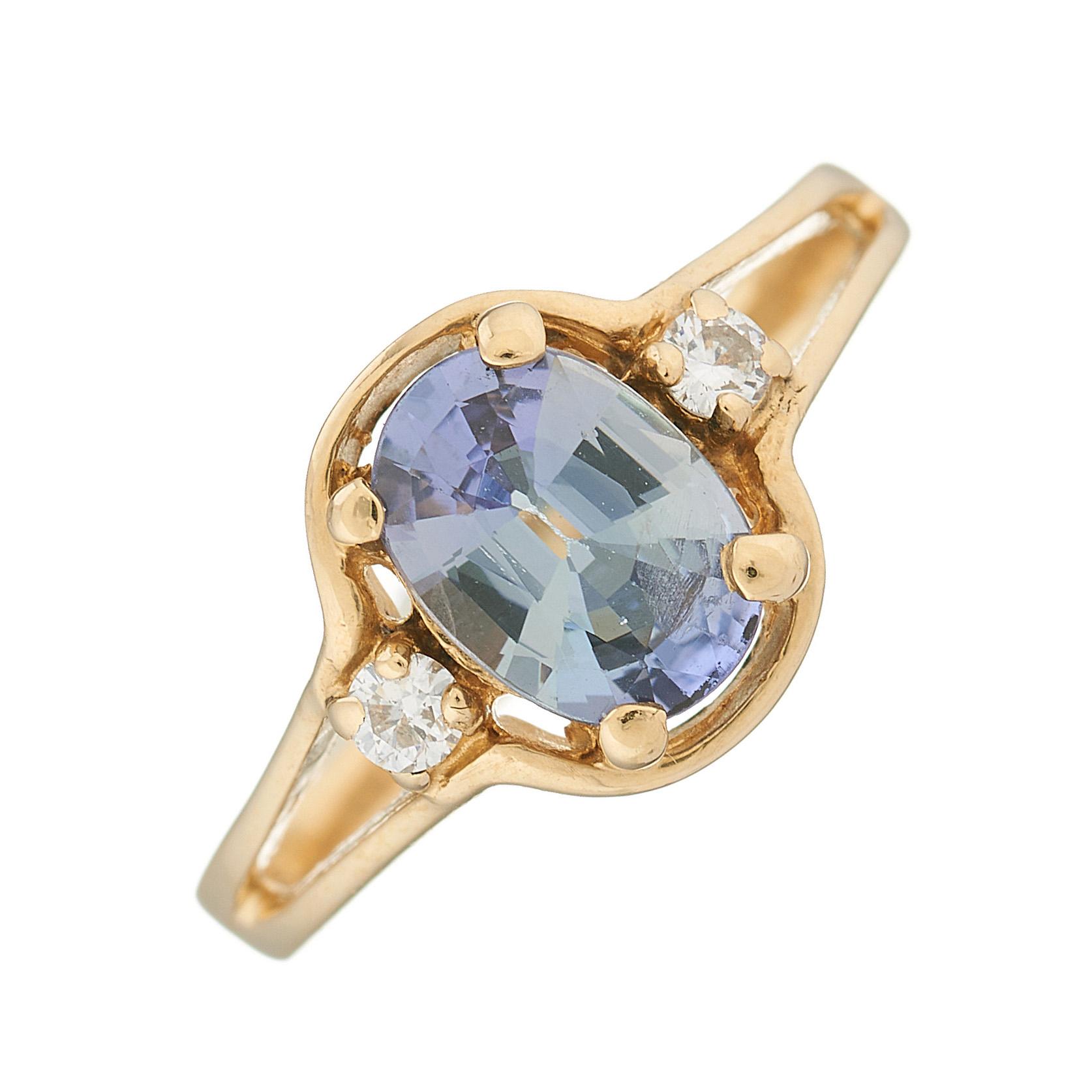 A 14ct gold tanzanite and diamond three-stone ring