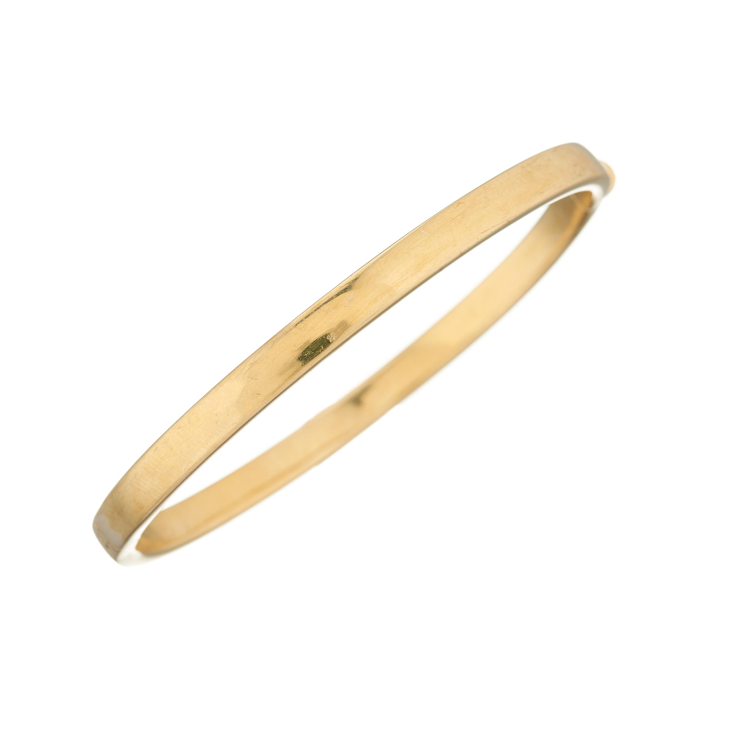 A 9ct gold hinged hollow bangle