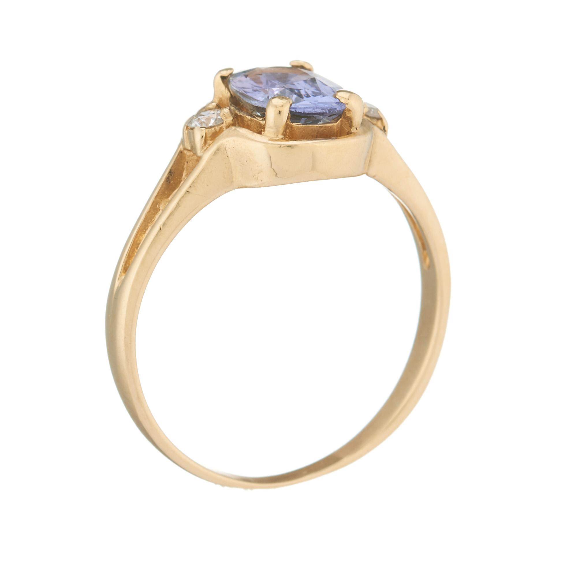 A 14ct gold tanzanite and diamond three-stone ring - Image 2 of 2