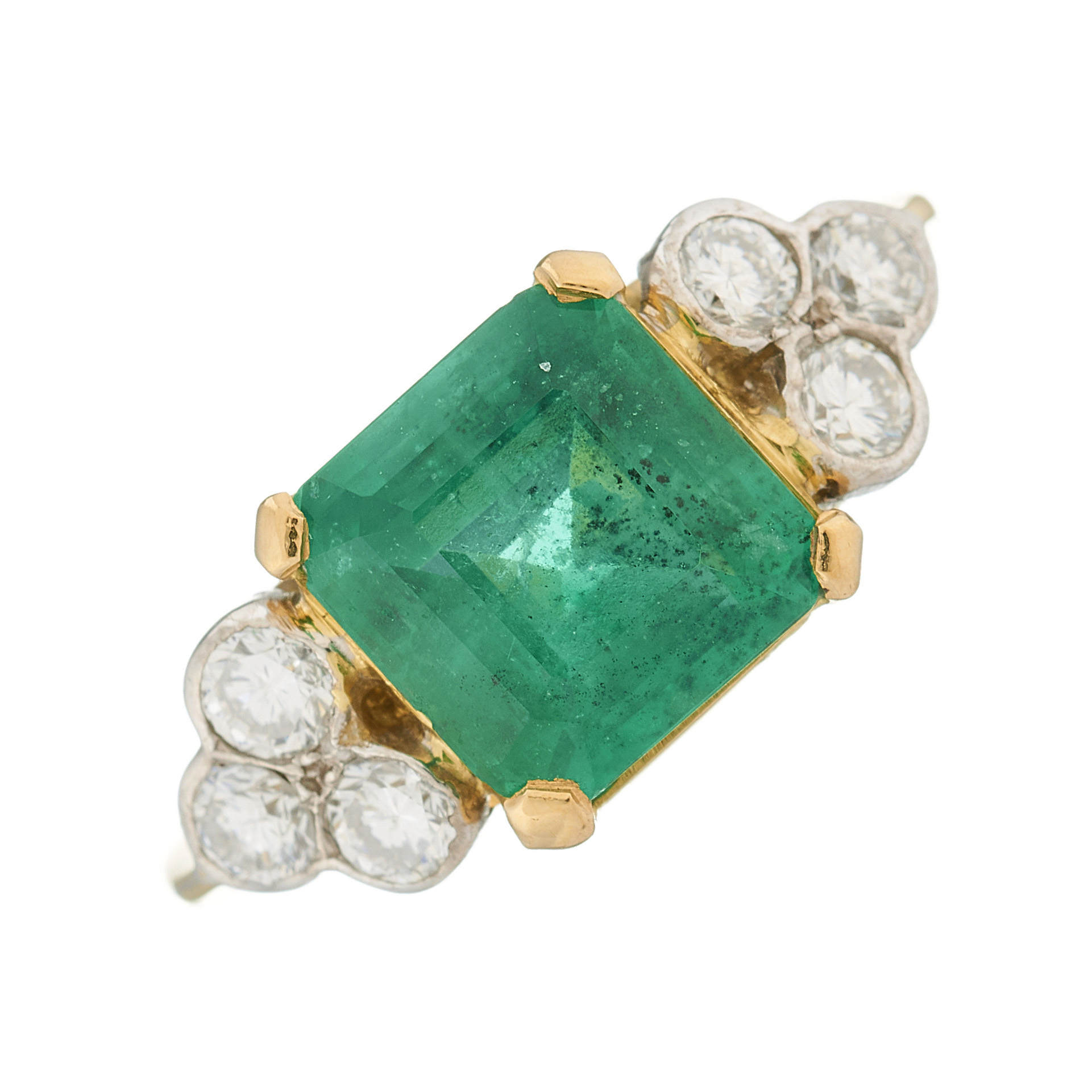 An 18ct gold emerald and diamond dress ring