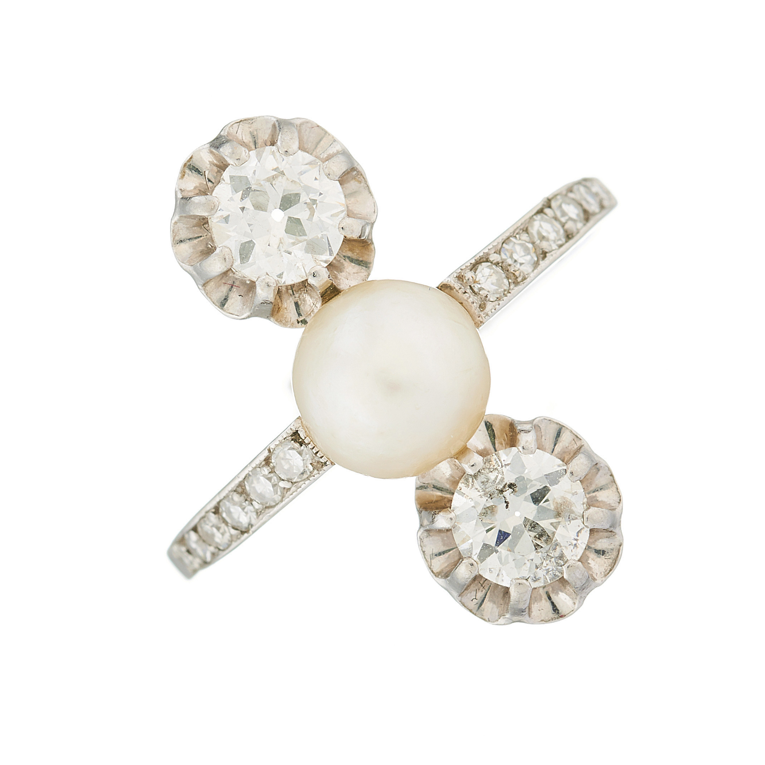 An Edwardian platinum, natural pearl and diamond three-stone dress ring