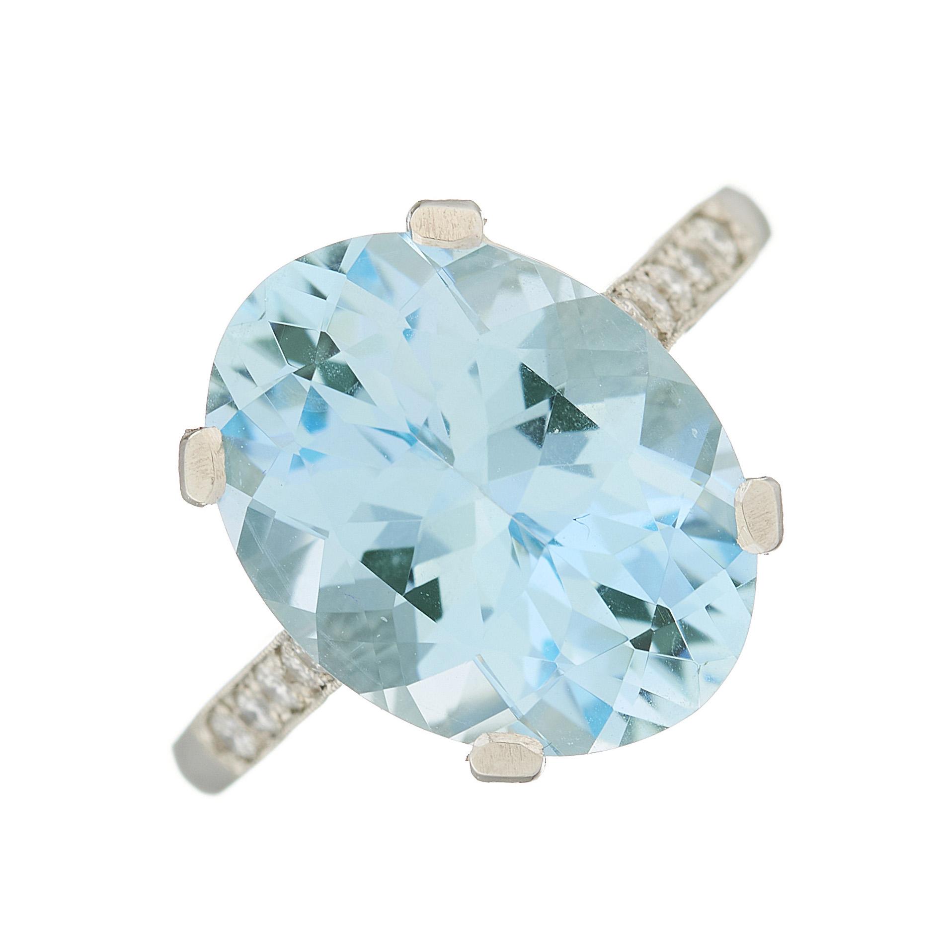 A platinum aquamarine single-stone and diamond dress ring