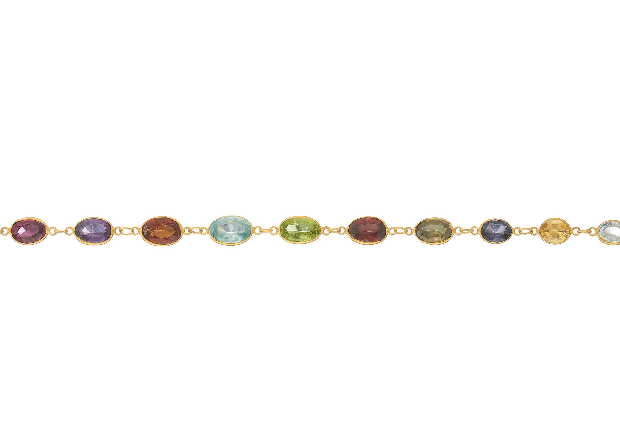 A 14ct gold harlequin multi-gem line bracelet