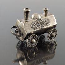 A novelty silver spice box