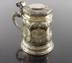 A 17th century German silver and parcel gilt lidded tankard, Johann Kartenbusch, Nuremberg