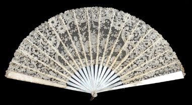 A large Brussels Mixed lace fan c 1890's, the leaf mounted on white Mother of Pearl, with bone ribs,