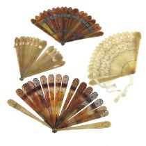 Four early 19th century brisé fans, to include a tortoiseshell (or possibly dyed horn) example, the