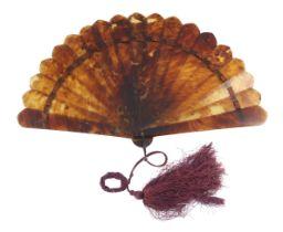 A An elegant circa 1880's tortoiseshell brisé fan with good mottling, the seventeen inner sticks and