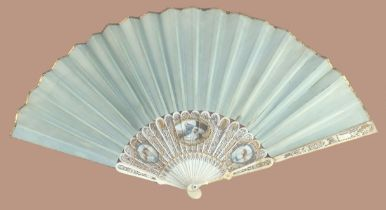 A slender 18th century ivory fan with sea green silk leaf, the monture finely painted with a central