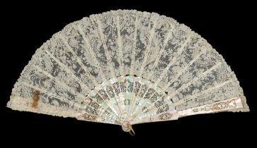 A late 19th century Brussels Point de Gaze needle lace fan, the pink Mother of Pearl carved, pierced