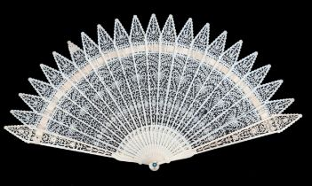 An early 19th century European ivory brisé fan, very finely carved with gothic tips to all sticks, t