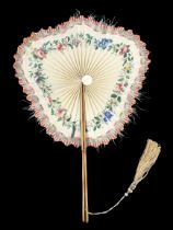 An unusual shaped 19th century cockade fan, the guards painted with flowers and varnished, the lower