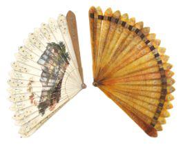 An early 19th century Peau d'ane or cream card Italianate souvenir fan, the guards of light wood, bo